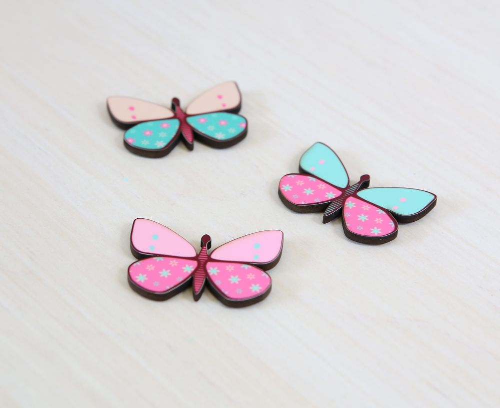 Three butterfly magnets