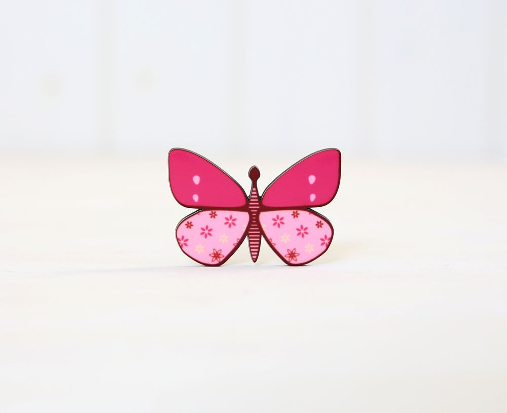 Three pink butterfly magnets